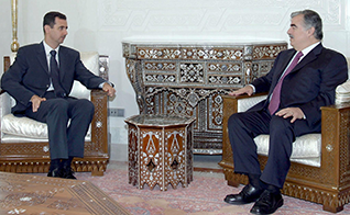 Rafic Hariri at his last meeting with President al-Assad of Syria, in 2004