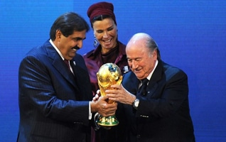 Emir Sheikh Hamad bin Khalifa Al Thani and his wife Sheikha Moza with FIFA Chairman Sepp Blatter after being elected to host the 2022 FIFA World Cup