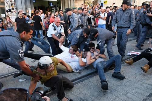 Police use force to disperse protesters at the Kikar Tzahal Square in Jerusalem. Hundreds of right wing Jewish protesters marched through Jerusalem calling for revenge following the murder of three Jewish settlers / Photo Corbis