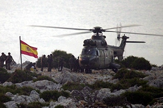 Spanish troops planting a flag on Isla Perejil in 2002