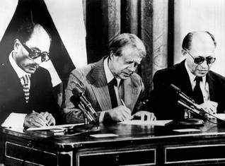 Signing of the Camp David accords by Sadat (from left), Carter and Begin right of return