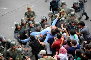A man is arrested by the police during the 2009 anti-government demonstrations Photo HH