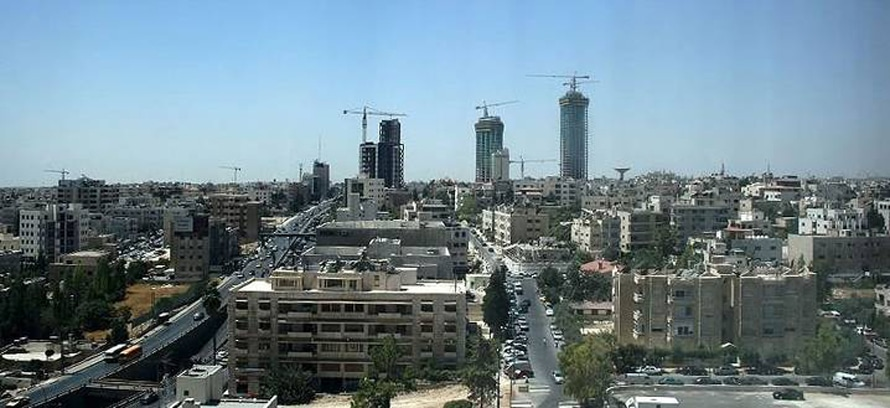 Economy Jordan - The Amman skyline with the Jordan Gate Towers on the horizon