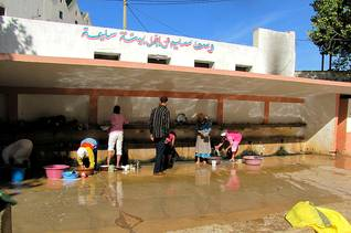 Geography Morocco - Washing of clothes in a public water facility in Bahlil