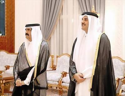 Former Emir Sheikh Hamad bin Khalifa Al Thani and his son, Emir Sheikh Tamim bin Hamad Al Thani