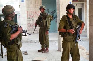 Israeli soldiers on patrol in the city of Bethlehem on the West Bank, May 2002