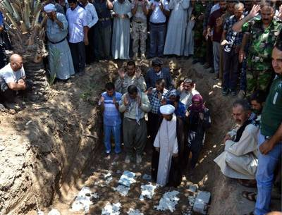 15 Iraqi Turkmen killed by the Islamic State of Iraq and the Levant (ISIL) in Tuz Khormato were burried in Kirkuk on June 23, 2014 / Photo Anadolu Agency