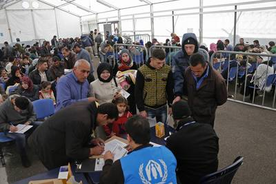 A family submitting an application at the UNHCR registration centre in Tripoli / Photo World Bank