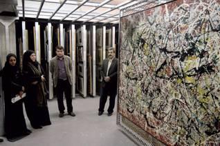 Qatari visitors looking at a Jackson Pollock painting