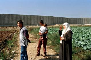 Palestinian farmers near the Wall in Qalqiliya in the West Bank Israeli occupation