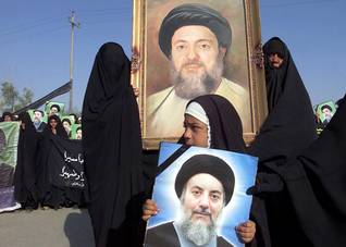 Portraits carried during the funeral of Ayatollah Sayyid Mohammad Baqir al-Hakim, killed on 29 August 2003 in a car bombing attack in Najaf Photo HH/NYT