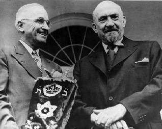 President Harry S. Truman and Israeli President Chaim Weizmann. Truman is holding a blue velvet mantle embellished with the Star of David, symbolizing Israel's gratitude for American recognition of and support for the new nation Photo Trumanlibrary.org
