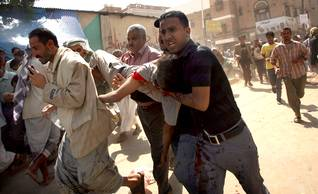Wounded demonstrators carried away during anti-Saleh protests in Sanaa, September 2011 Photo HH