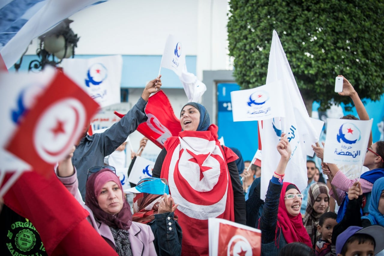 Tunisians take part in a campaign rally near Bourguiba Avenue, Tunis, 24 October 2014 / Photo Corbis