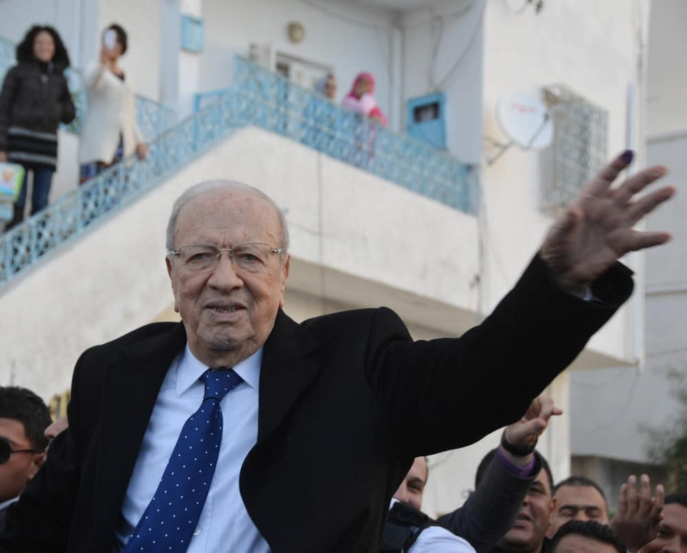 Presidential candidate Beji Caid Essebsi among his supporters, after casting his vote at a polling station in Tunis, 21 December 2014 Photo Eyevine/Hollandse Hoogte