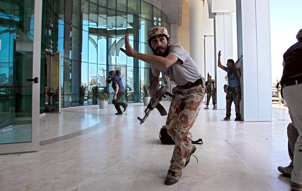 libyan rebels during their opreation to protect and release the jornalistis from Corinthia hotel in tripoli Libya