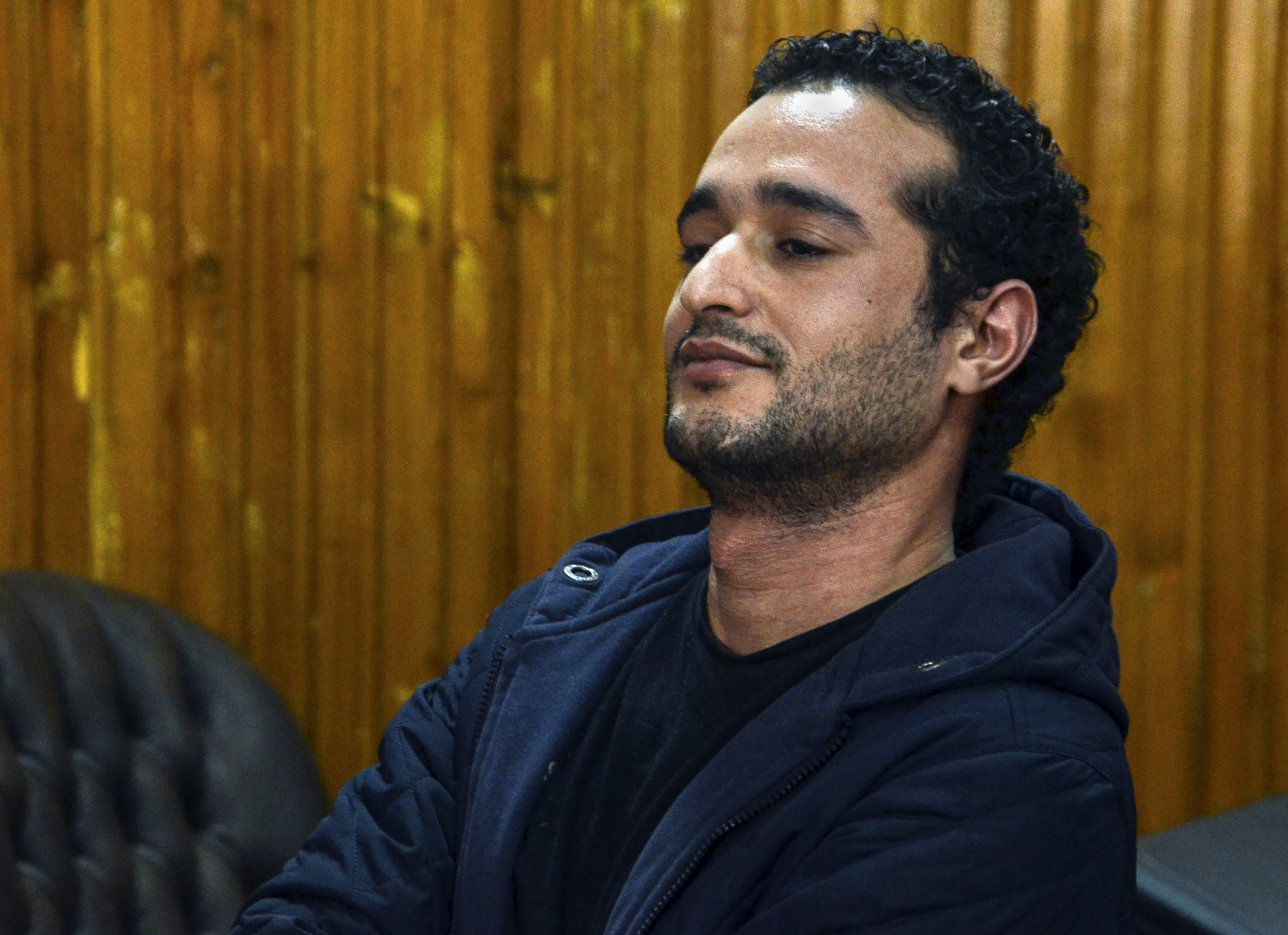 "Ahmed Douma, one of the leading activists behind Egypt's 2011 uprising, attends a court hearing in a case against 230 people including Douma, for taking part in clashes between protesters and security forces, in a courtroom of Torah prison, Cairo, Egypt, Wednesday, Feb. 4, 2015. Judge Mohammed Nagi Shehata found them guilty and sentenced them, including Douma, to life in prison. Last year, Egypt's powerful lawyers union criticized Shehata for ""disparaging"" and ""terrorizing"" Douma's defense team after he referred five of the team's six lawyers to prosecutors for investigation. The union instructed all members to boycott Shehata's court. (AP Photo/Mohammed El-Raaei)"