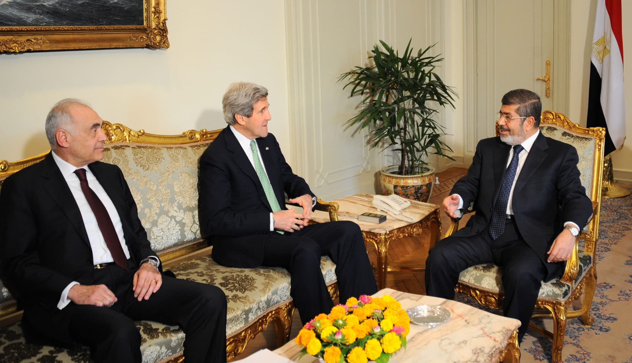 Secretary of state John Kerry and Egyptian president Muhammad Morsi meet at the presidential palace in Cairo.