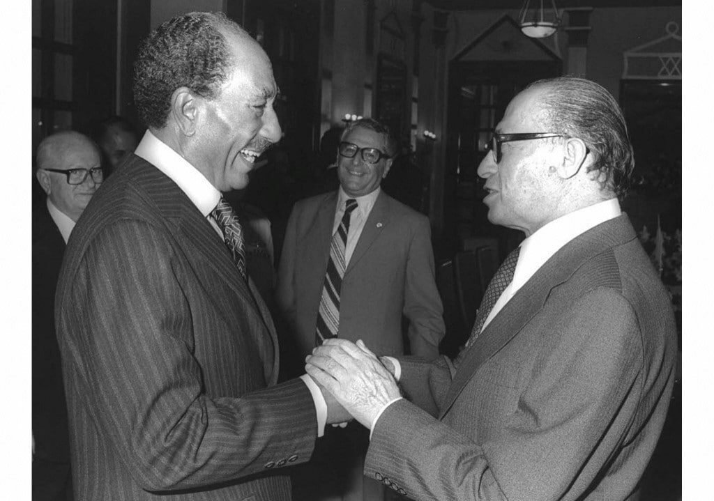 Egyptian President Anwar Sadat is welcomed by Israeli Prime Minister Menachem Begin in the Knesset 1977