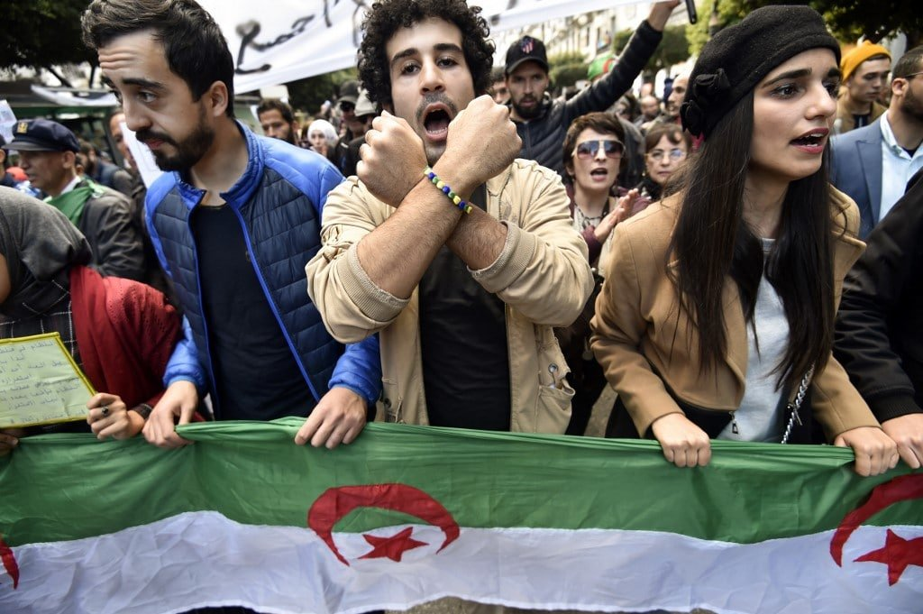 Algerian anti-government protesters chant slogans