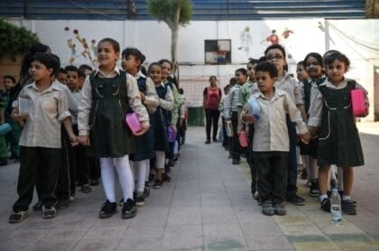 children line up for school