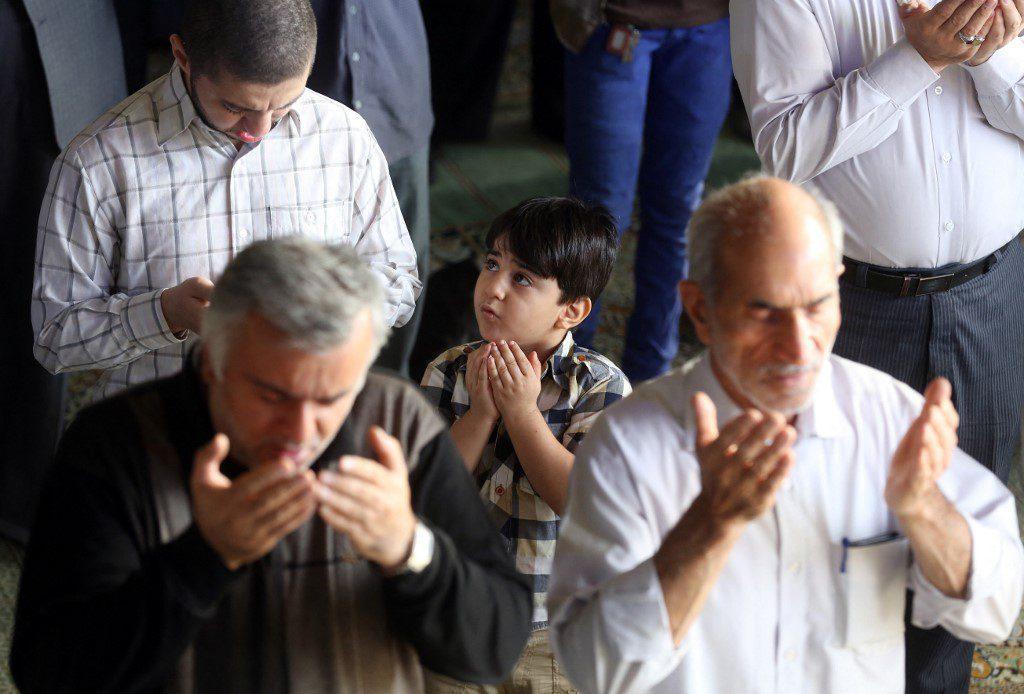 Iranians perform the Eid al-Adha prayers