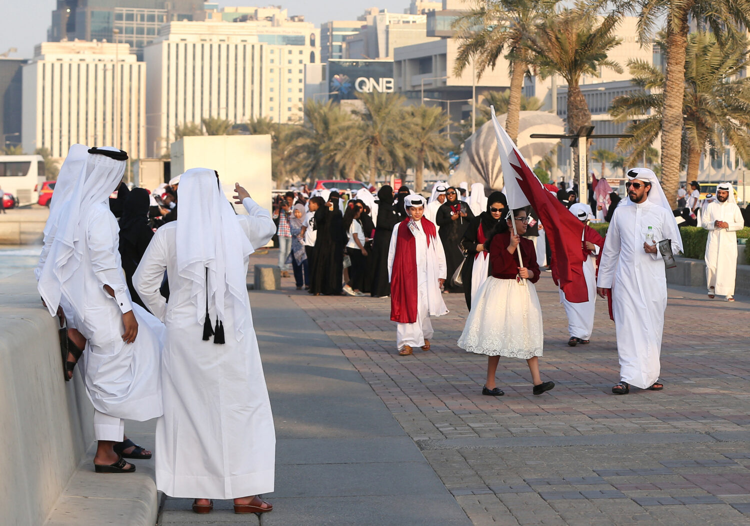 Qataris take to the streets of Doha to welcome back the Emir