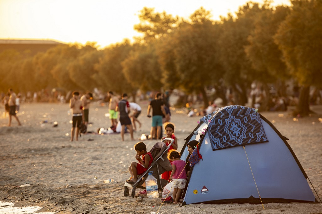 A Syrian family is seen in a tent on the beach at Menekse in Istanbul