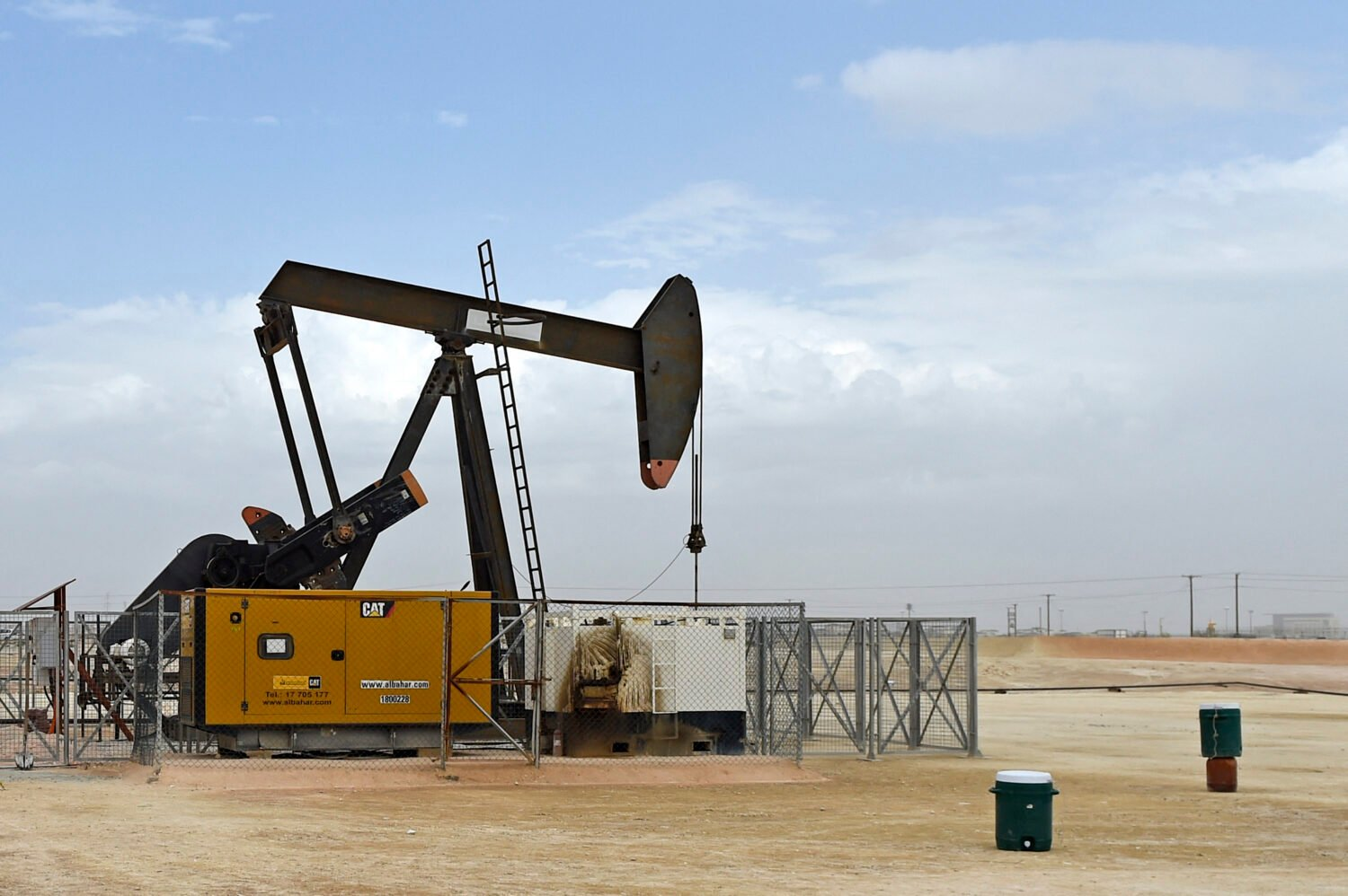 A pumpjack operates in the desert oil fields of Sakhir in southern Bahrain