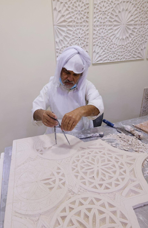 A stone mason works on handicraft