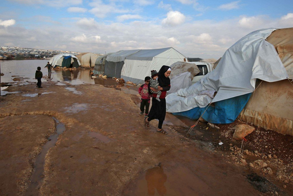 woman in a refugee camp