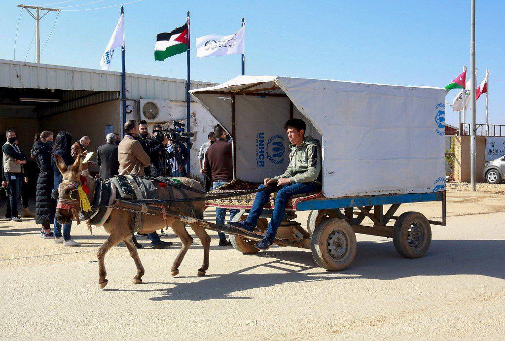 A Syrian refugee rides a donkey-cart at the Zaatari refugee camp