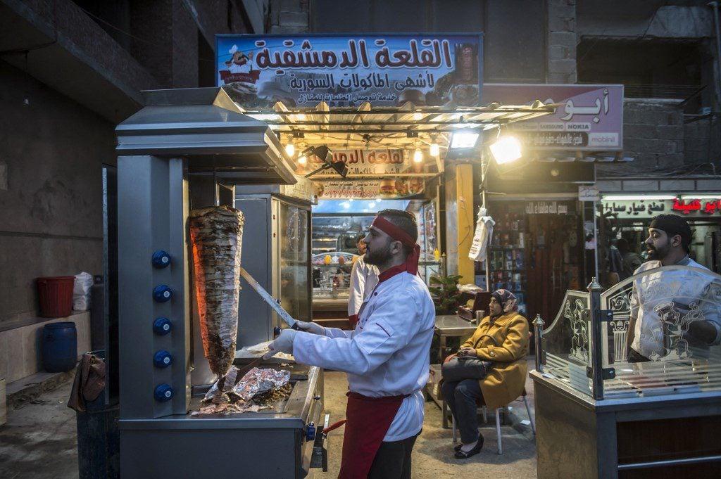 Syrian refugee Adel Bazmawi works at a restaurant