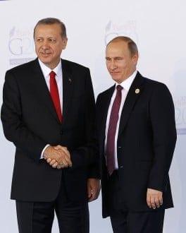 ANTALYA, TURKEY - NOVEMBER 15 : Turkish President Recep Tayyip Erdogan (L) greets Russian President Vladimir Putin (R) during the 'Welcoming Ceremony' prior to the G20 Turkey Leaders Summit on November 15, 2015 in Antalya, Turkey. Mehmet Ali Ozcan / Anadolu Agency