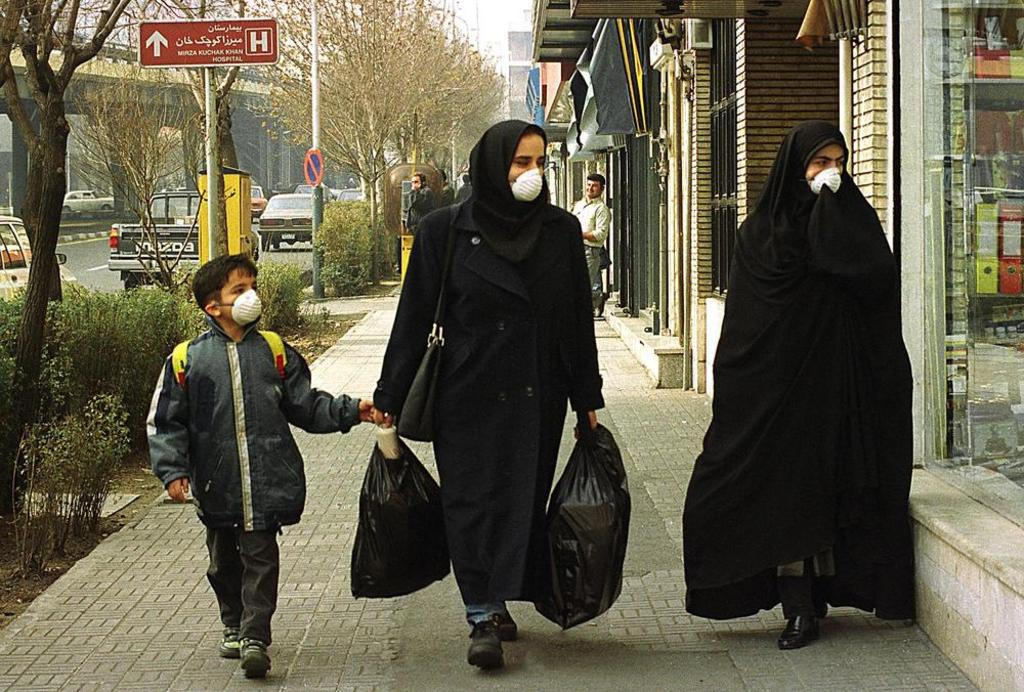 Iranians protecting their faces from air pollution in downtown Tehran