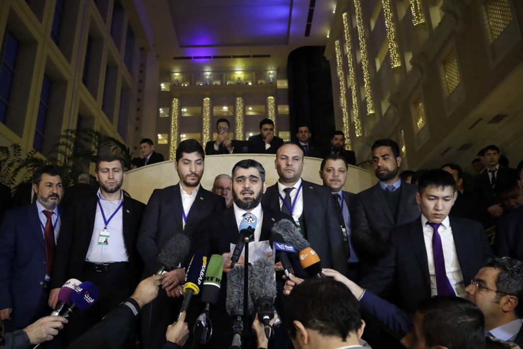 Mohammed-Alloush-head-of-the-Syrian-opposition-delegation