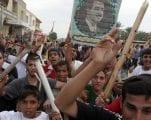 """كيف ساهمت أيديولوجية صدام حسين القديمة في تنظيم """"الدولة الإسلامية"""" الحديث"""