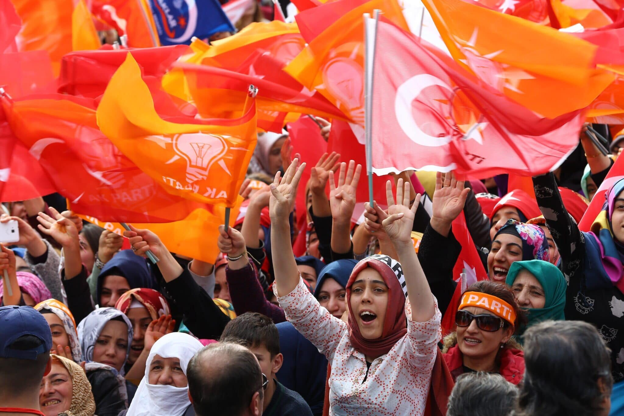 Supporters wave flags as Turkish Prime Minister and Justice and Development (AK) Party leader, Ahmet Davutoglu holds an election campaign rally in Van province of Turkey on October 20, 2015