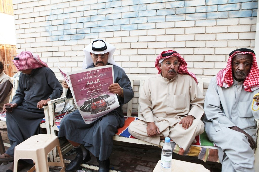 Kuwait media man reads newspaper