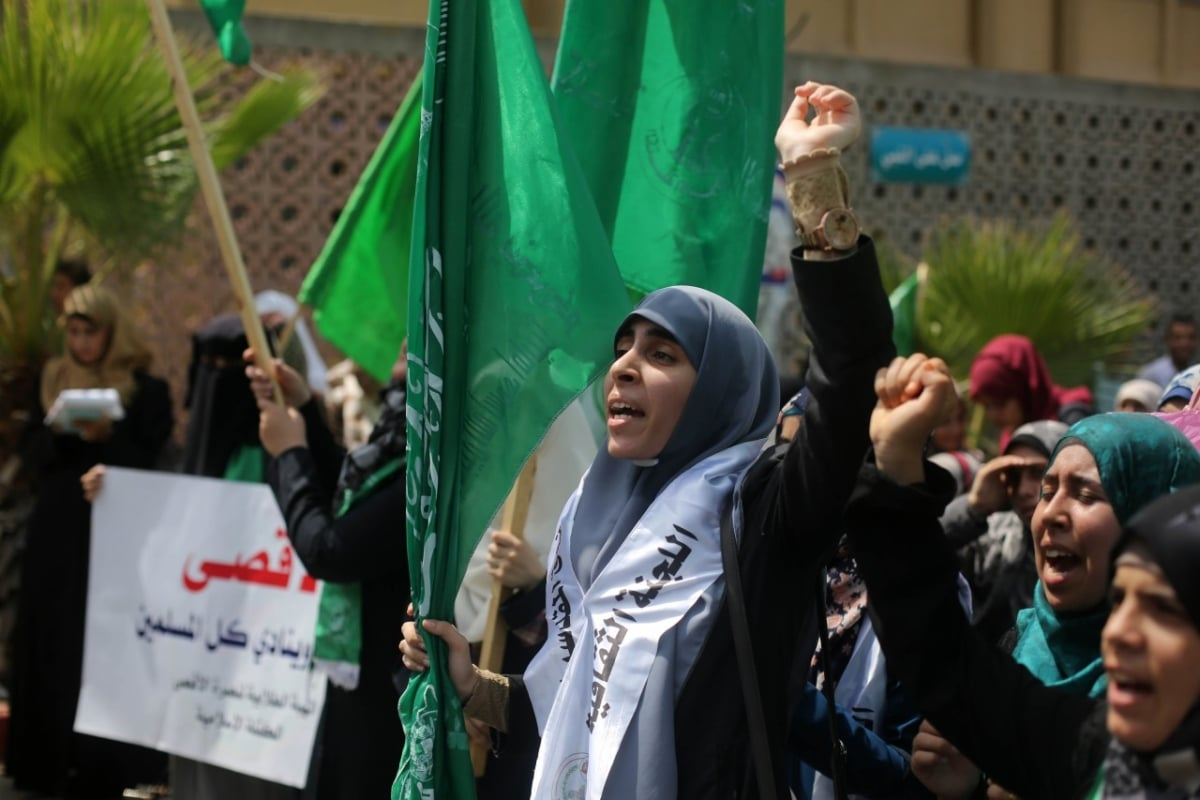 12 Sep 2015, Gaza, Gaza Strip --- Female Hamas militant group supporters as they chant slogans during a rally in gaza city. after clashes erupted at the compound between Palestinians and Israeli police at Al-Aqsa mosque in Jerusalem's Old City on September 13, 2015, just hours before the start of the Jewish New Year. The disturbances came with tensions running high after Israeli Defence Minister Moshe Yaalon last week outlawed the Murabitat (for females) and Murabitun groups which are made up of east Jerusalem Palestinians and Israeli Arabs and who confront Jewish visitors to the volatile Al-Aqsa mosque complex, considered Islam's third holiest shrine. (Photo by Majdi Fathi/NurPhoto) --- Image by © Majdi Fathi/NurPhoto/Corbis