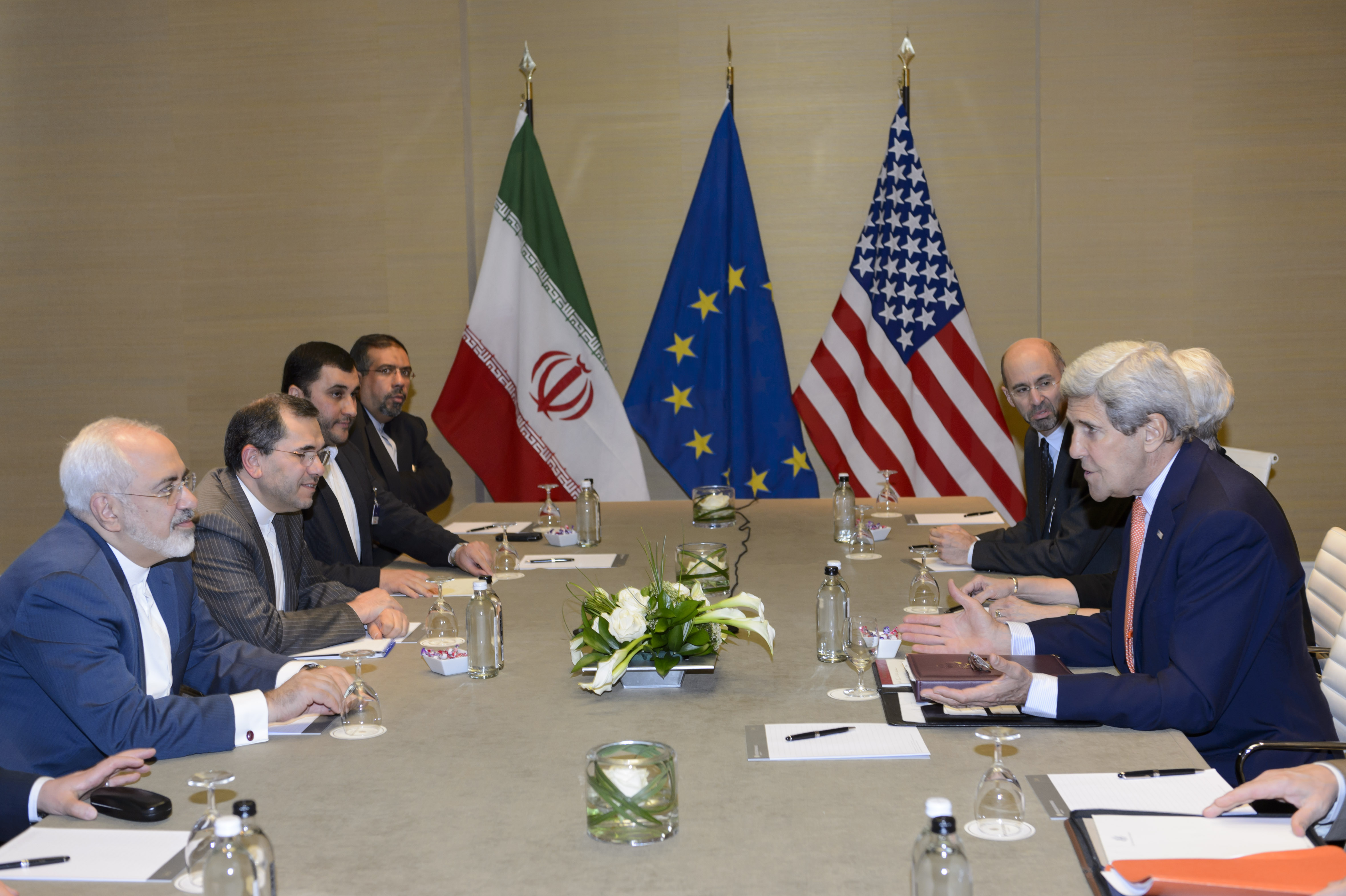 International Affairs - U.S. Secretary of State John Kerry, right, speaks with Iranian Foreign Minister Mohammad Javad Zarif, left, prior to a bilateral meeting for a new round of Nuclear Talks with Iran at the Intercontinental Hotel, in Geneva, Switzerland, Saturday, May 30, 2015. A month out from a nuclear deal deadline, the top U.S. and Iranian diplomats gathered in Geneva Saturday in an effort to bridge differences over how quickly to ease economic sanctions on Tehran and how significantly the Iranians must open up military facilities to international inspections. (Laurent Gillieron/Keystone via AP)