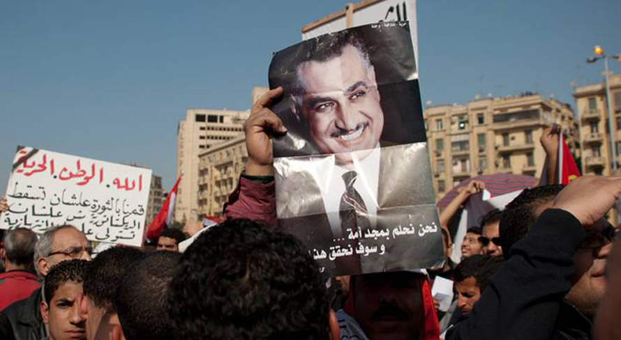 Governance Egypt - Protesters showing a poster of President Gamal Abdel Nasser, February 2012