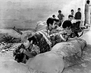 Fedayeen fighters in the streets of Amman during Black September in 1970 / Photo Keystone/HH
