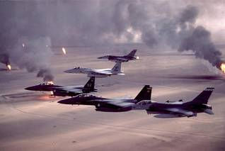 Coalition aircraft flying over burning oil wells