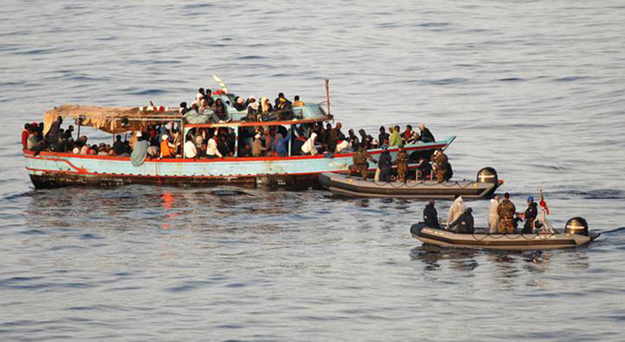 Italian Navy entering a boat off the Libyan coast with 300 migrants, trying to reach Lampedusa / Photo NATO