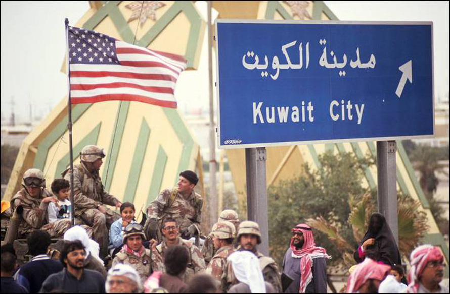 Residents of Kuwait City acclaim the American troops after defeating the invading Iraqi army