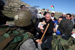 Israeli soldiers and Palestinian protesters from the West Bank village of Nabi Salih during clashes on 15 January 2010. The Palestinians were demonstrating against Israeli settlers from the nearby Jewish settlement of Halamish. Photo HH