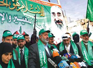 Hamas leader Ismail Haniyeh speaks at a mass demonstration