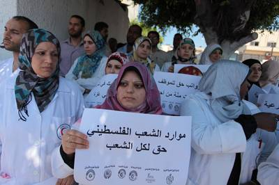 Palestinian Doctors of the formerly Hamas-run government in the Gaza Strip protest to demand their salaries, 24 June 2014 / Photo APAimages/REX