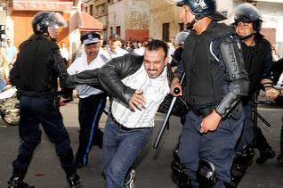 شرطة مكافحة الشغب أثناء أداء مهامها Photo Flickr